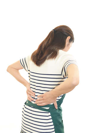 Woman who has a back pain. 免版税图像