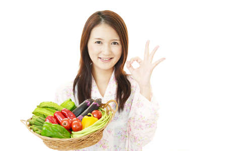 Smiling woman with vegetables.
