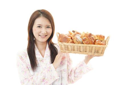 Portrait of woman having breakfast. 免版税图像