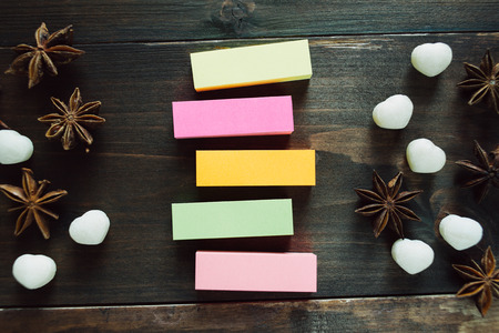 sweeties: Colorful blank stickers and sweeties on the wooden background