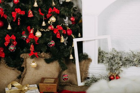 dreamlike: New Years interior with Christmas tree and gifts Stock Photo
