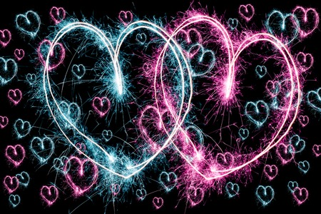 love blast: sparkler firework background with blue and pink hearts