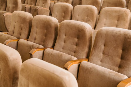 lecture theatre: Empty brown velvet seats in auditorium for meeting