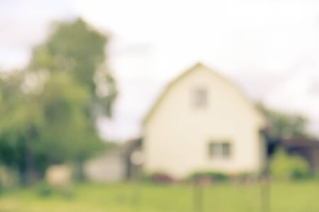 countrified: Blurred abstract countrified background with house outdoor in summer village, copy space, lens blur