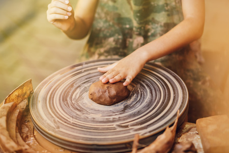 Child learning clay modeling