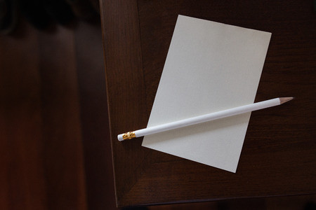 note paper: note paper and pencil on old wooden table Stock Photo