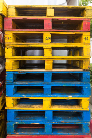 distribution board: background of colorful wooden cargo pallets