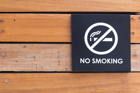 abstain: No Smoking Sign on wooden wall
