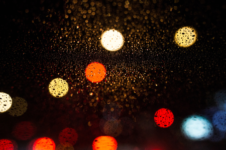 neon lights: Decorative neon lights in soft focus, raining Stock Photo