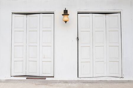 doorframe: white doors and lamp on a white wall Stock Photo