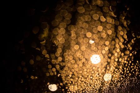 vague: Decorative neon lights in soft focus, raining Stock Photo