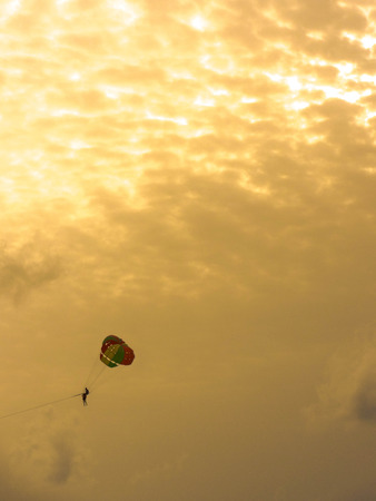 extreme Parachute on the golden sky at afternoon. outdoor photo.