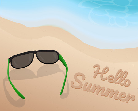 Sunglasses place on sand at the beautiful beach and shading blue tone of wave and writing Hello Summer on the sand.