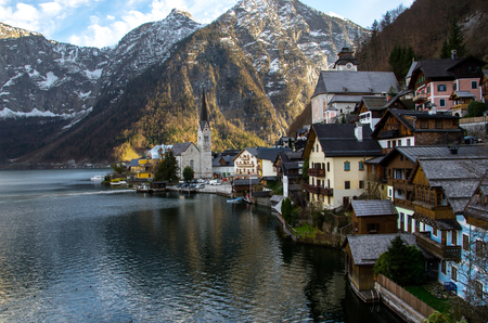 Village with iconic church, lake and mountain background at Hallstatt, Austria photo