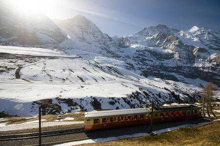 jungfraujoch: Swiss train to JungfrauJoch with Alps background Editorial