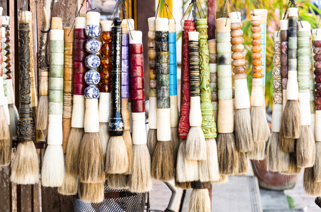 tuft: Traditional tuft for souvenir in Laos Stock Photo