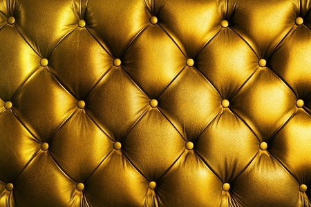 Saturated glossy gold leather texture of sofa chair