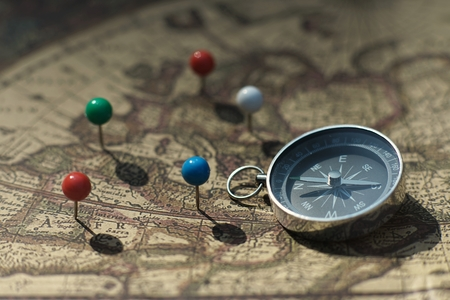 Compass and pin point marking with vintage world map background Stok Fotoğraf