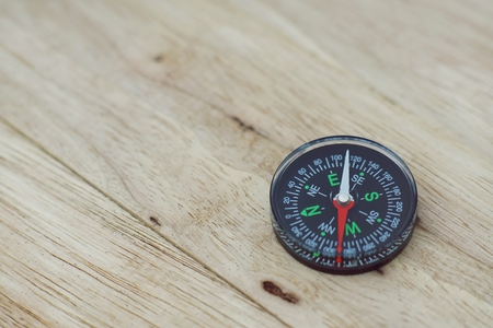 Compass on wooden table, journey concept, copy space Stok Fotoğraf