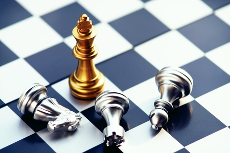 Chess board game, gold and silver team, business competitive concept