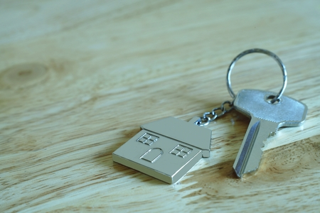 House key with home keyring, real estate concept, copy space