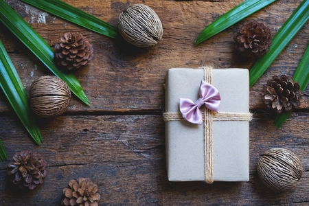 Eco friendly gift boxes wrapped with brown paper, green happy new year present concept, copy space