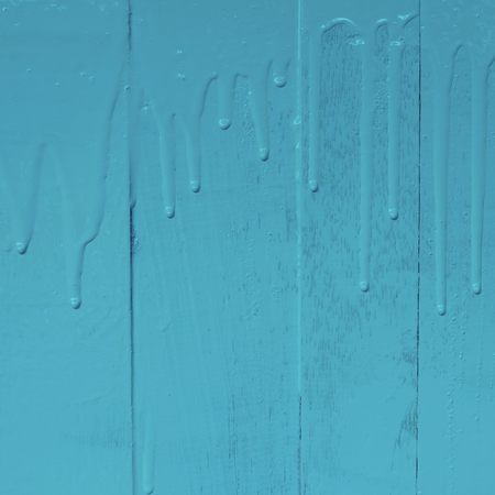 Wooden wall painting by oil color paint with pouring drip texture pattern, 1:1, copy space, pastel blue color