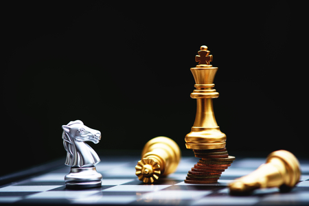 Chess board game, business competitive concept, strong financial capital advantage situation against unstable finance team, winner and loser Stock Photo
