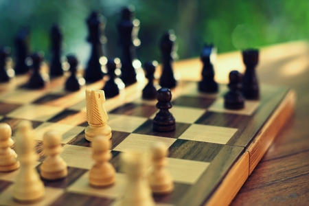 Chess board game, business competitive concept, encounter difficult situation, losing and winning, copy space Imagens