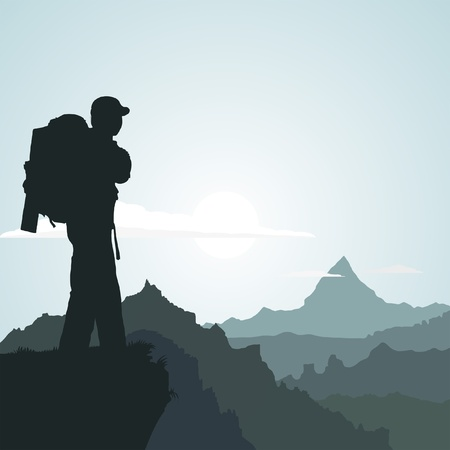 hiker: Hiking man with rucksack in mountain in the morning