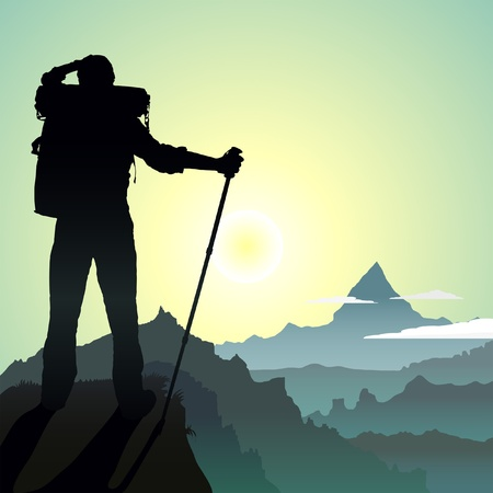 man hiking: Hiking man with rucksack in mountain in the morning