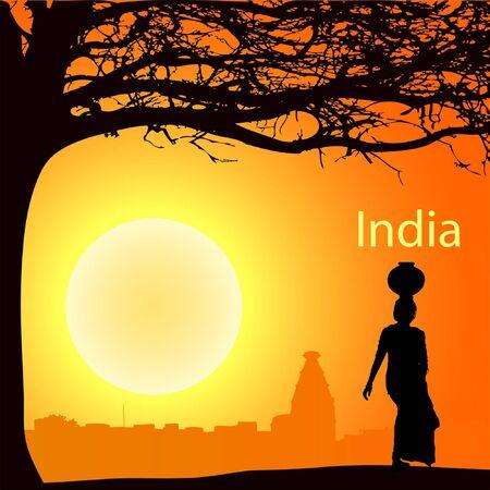 hinduismo: Las mujeres indias con olla en la cabeza en el sunsetr
