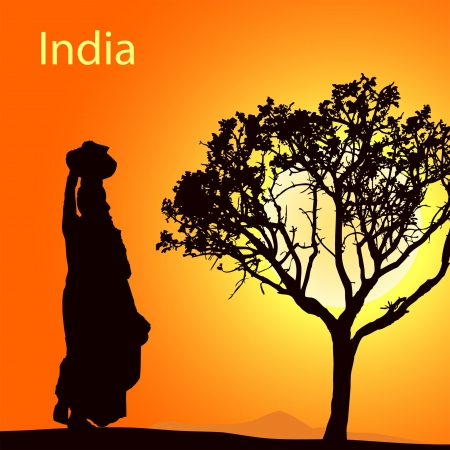 indian summer: Indian women with pot on the head at the sunsetr