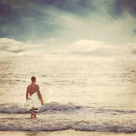 male surfer: beach background Stock Photo