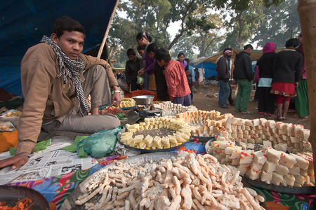 nepali: nepali street seller sells cakes during a fait in Nepal