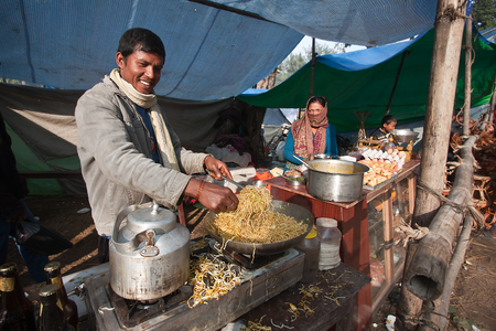 nepali: Nepali man cooking on the occasion of Maghy festival, Nepal