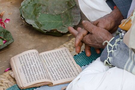 hinduist: a hinduist priest is reading mantra during Shivaratri festival, Nepal