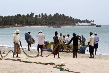 india fisherman: fishermen at work, at Uppuveli, Sri Lanka
