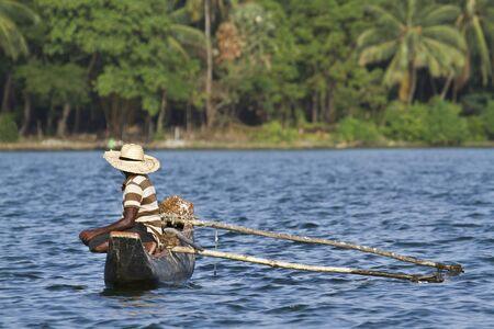 dugout: traditional dugout canoe fisherman on His in Sri Lanka Stock Photo