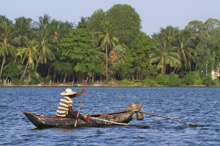 dugout: His dugout canoe fisherman on Sri Lanka Stock Photo