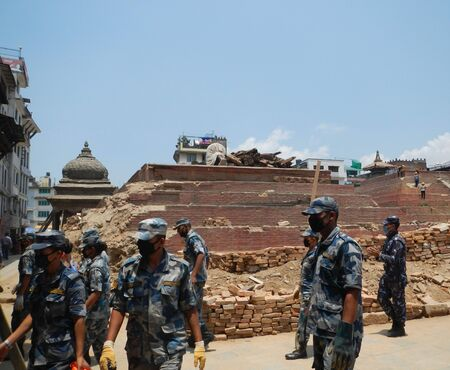 looking after: Looking After soldiers Bhuddist temples destroyed by earthquake at Durbar Square Kathmandu