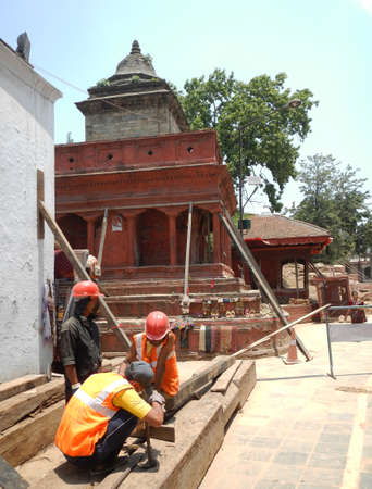 damaged roof: workers fixing damaged lines are temples earthquakes After Durbar Square Kathmandu