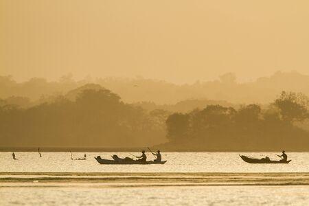 uncluttered: fishermen on a boat, on sunset, Arugam Bay, Sri lanka Stock Photo