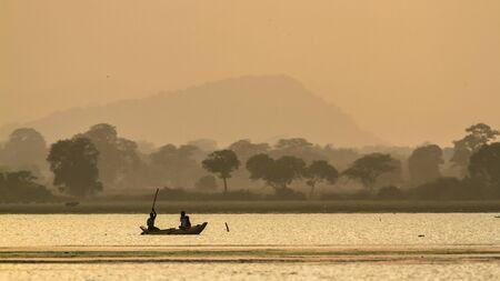 uncluttered: traditional fishermen on sunset, at Arugam Bay, Sri lanka Stock Photo