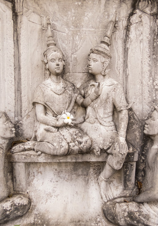 fresco: Wall fresco couple of buddhist celebrities, stone carving, Bangkok, Thailand