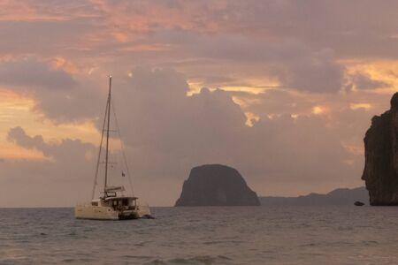 mook: catamarans on sunset at Koh Mook island, Thailand Stock Photo