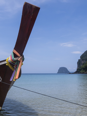 riff: detail of a long tail boat on a paradise beach at Koh Mook Island, Thailand