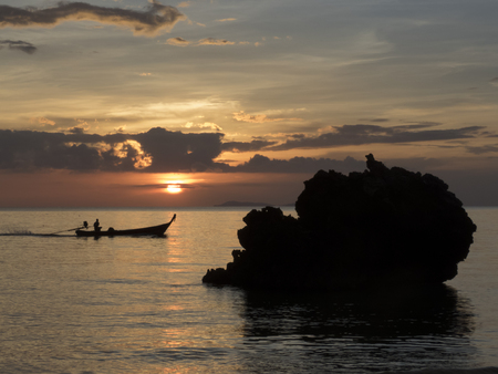 riff: fishing boat and sunset, Haad Yao Beach, Thailand