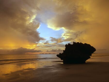 riff: stunning sunset and rock after a storm at Haad Yao Beach, Thailand