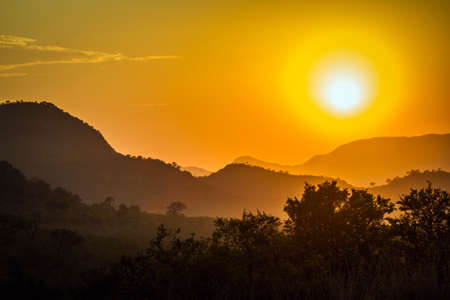 kruger park: stunning sunset and mountain in savannah, Kruger Park, South Africa